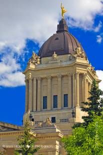 Stock photo shows the dark impressive dome with the golden boy statue sits atop the Legislative Building.