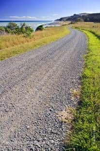 Stock photo of a gravel road at the Hurunui River Mouth near Cheviot, East Coast, South Island, New Zealand.