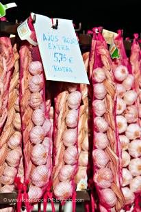 Stock photo of Garlic hanging outside a store along the road to the town of Guadalest, Costa Blanca, Province of Alicante, Comunidad Valenciana, Spain, Europe.