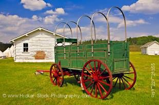 Stock photo of a green wagon outside the stables at Fort Walsh National Historic Site, Cypress Hills Interprovincial Park, Saskatchewan, Canada.