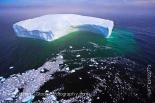 Stock photo of a large iceberg as seen from the air in the Strait of Belle Isle in Southern Labrador in Newfoundland, Canada.