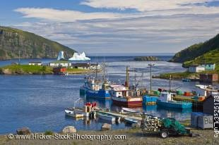 Stock photo of an iceberg stranded in the harbour of Old Bonaventure, Bonavista Peninsula, Trinity Bay, Newfoundland Labrador, Canada.