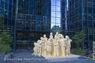 Stock photo of The Illuminated Crowd by artist Raymond Mason at the entrance to the BNP Tower - Laurentian Bank Tower in downtown Montreal, Quebec, Canada.