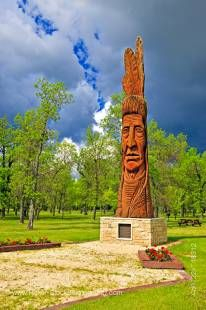 Stock photo of Cedar carving of an Indian head named Whispering Giant (which honours the Ojibwa, Cree, and Assiniboine First Nations) in Winnipeg Beach Provincial Recreation Area, in the town of Winnipeg Beach, Manitoba, Canada.