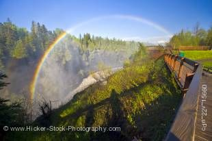 Stock photo of a rainbow in the mist above the boardwalk at Kakabeka Falls (aka the Niagara of the North) along the Kaministiquia River during a Spring flood, Kakabeka Falls Provincial Park near Thunder Bay, Ontario, Canada.