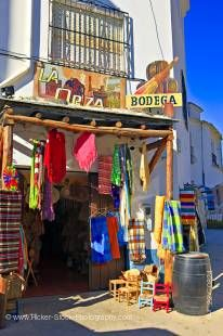 Stock photo of Hand woven blankets and clothing outside La Orza Bodega and gift store in the town of Trevelez, Las Alpujarras, Sierra Nevada, Parque Natural de Sierra Nevada, Province of Granada, Andalusia (Andalucia), Spain, Europe.