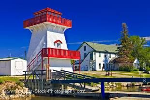 Stock photo of a red and white lighthouse at the marina in Gull Harbour, Lake Winnipeg, Hecla Provincial Park, Hecla Island, Manitoba, Canada.