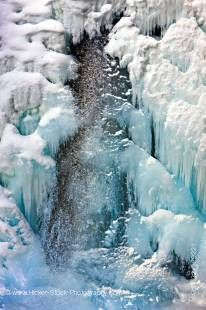 Stock photo of a frozen Lower Falls of the Johnston Creek during winter with ice and snow formations, Johnston Canyon, Banff National Park, Canadian Rocky Mountains, Alberta, Canada.