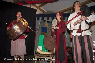 Stock photo shows Medieval musical band members entertaining guests during a medieval feast at Schloss Auerbach (Auerbach Castle), Bensheim-Auerbach, Hessen, Germany, Europe.