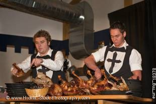 Stock photo of men carving the roast geese during a medieval feast at Schloss Auerbach (Auerbach Castle), Bensheim-Auerbach, Hessen, Germany, Europe.
