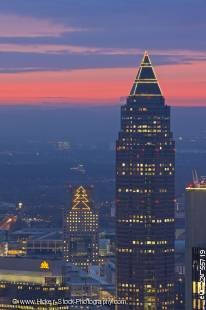 Stock photo of sunset over the Messeturm skyscraper and the City of Frankfurt am Main, Hessen, Germany, Europe.