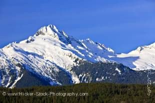Stock photo of the snow covered Mount Tantalus (2603 metres/8540 feet), Tantalus Mountain Range, Coast Mountains, British Columbia, Canada.