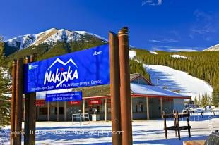 Stock photo of a sign at the entrance to the base station of Nakiska Ski Resort during winter on the slopes of Mount Allan (2789 metres/9150 feet), the site of the Alpine Events of the 1988 Olympic Winter Games, Evan-Thomas Provincial Recreation Area