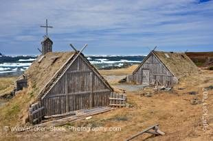 Stock photo of Re-created huts and buildings at the Norstead Viking Site (a Viking Port of Trade) backdropped by pack ice in the harbour, Trails to the Vikings, Viking Trail, Great Northern Peninsula, Northern Peninsula, Newfoundland, Canada.