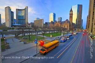 Stock photo of both the old and new City Hall Buildings and Nathan Phillips Square and street scene in downtown Toronto, Ontario, Canada.