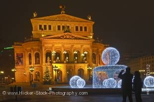Stock photo of the exquisitely detailed Old Opera House, Alte Oper Frankfurt, and its fountain decorated with lights, at night, downtown Frankfurt, Hessen, Germany, Europe.