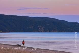 Stock Photo of people on the beach in Agawa Bay during sunset in Lake Superior Provincial Park, Ontario, Canada.