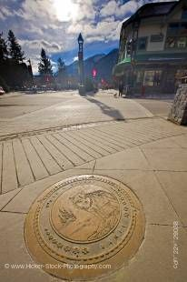 Stock photo of decorative plaque in the footpath at the corner of Banff Avenue and Wolf Street in downtown Banff, Banff National Park, Canadian Rocky Mountains, Alberta, Canada. Banff National Park forms part of the Canadian Rocky Mountain Parks UNESCO Wo