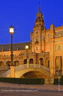 Stock photo of the central building and bridge at Plaza de Espana, Parque Maria Luisa, during dusk in the City of Sevilla (Seville), Province of Sevilla, Andalusia (Andalucia), Spain, Europe.