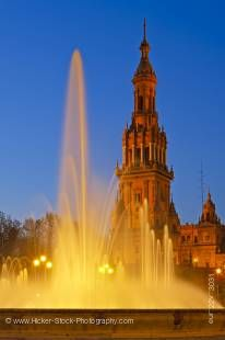 Stock photo of the tower and fountain at the Plaza de Espana, Parque Maria Luisa, during dusk in the City of Sevilla (Seville), Province of Sevilla, Andalusia (Andalucia), Spain, Europe.