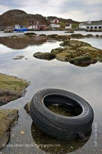 Stock photo of a car tire in the harbour in the town of Great Brehat along Highway 430-76, Viking Trail, Trails to the Vikings, Great Northern Peninsula, Northern Peninsula, Newfoundland, Canada.