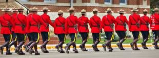 Panoramic stock photo of men and women marching in sync in the Sargeant Major's Parade and Graduation ceremony at the RCMP Academy, City of Regina, Saskatchewan, Canada.