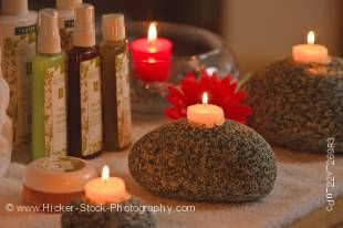 Stock photo of beauty products and tea light candles creating a beautiful relaxing atmosphere.