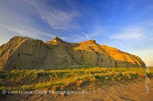 Stock photo shows Castle Butte during sunset in the Big Muddy Badlands, Southern Saskatchewan, Canada.