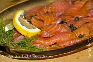 Stock photo of salmon slices laid out on a platter at the Rifflin' Hitch Lodge in Southern Labrador, Labrador, Canada.