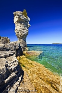 Stock photo of the rocky shoreline and the Sea Stack of Flowerpot Island in the Fathom Five National Marine Park, Lake Huron, Ontario, Canada.