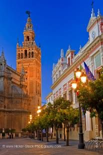 Stock photo of the Seville Cathedral and La Giralda (bell tower/minaret), a UNESCO World Heritage Site, seen from Plaza del Triunfo at Dusk, Santa Cruz District, City of Sevilla (Seville), Province of Sevilla, Andalusia (Andalucia), Spain, Europe.