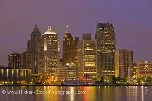 Stock photo of the lighted skyline at night of Detroit city, Michigan, USA seen from the waterfront in the city of Windsor, Ontario, Canada.