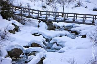 Stock photo of snow and ice formations near the bridge across the Fitzsimmons Creek between Whistler and Blackcomb Mountains during winter, Whistler, British Columbia, Canada.