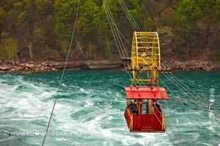 Stock photo of the Spanish Aero Car going down stream from the Niagara Falls passing above the Whirlpool Rapids of the Niagara River, Niagara River Parkway, Ontario, Canada.