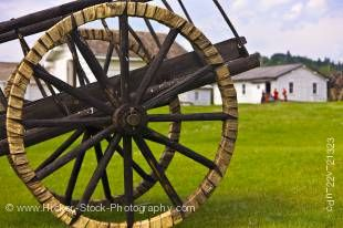 Stock photo of spoke wheels of a Red River cart with tires made of shaganappi (rawhide) on display at Fort Walsh National Historic Site, Cypress Hills Interprovincial Park, Saskatchewan, Canada.