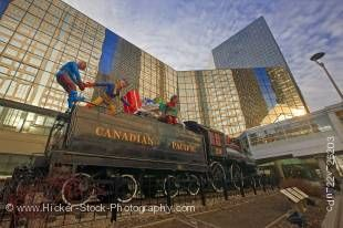 Stock photo of a Christmas display on the CPR Steam Locomotive 29, Canadian Pacific Railway Headquarters building in Gulf Canada Square, City of Calgary, Alberta, Canada.