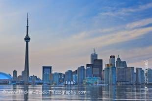 Stock photo of the Toronto City Skyline at dusk as seen across Lake Ontario from Centre Island in the Toronto Islands in Ontario, Canada.