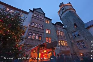 Stock photo of the tower and facades of buildings with windows illuminated with lights from the inside at Burg Ronneburg (Burgmuseum), Ronneburg Castle, during the medieval markets, Ronneburg, Hessen, Germany, Europe.