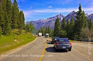 Stock photo of cars and campers at a stop to view the Bighorn sheep in Banff National Park, Alberta, Canada.
