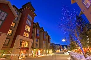 Stock photo of decorative lighting along the Village Stroll at dusk, Whistler Village, British Columbia, Canada. A background of beautiful deep blue sky adds to this scenic capture of this lovely village illuminated at dusk.