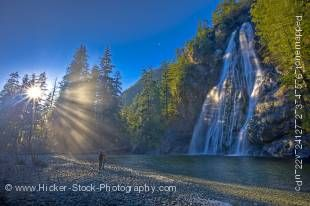 Stock photo of couple enjoying mountain view and water falls of Virgin Falls, Tofino Creek, Vancouver Island, British Columbia.