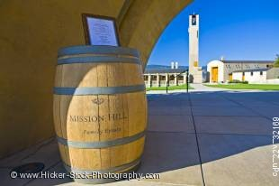 Stock photo of wine barrel and sign at the entrance to Mission Hill Family Estate Winery, Westbank, West Kelowna, Kelowna, Okanagan, British Columbia, Canada.