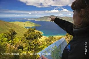 Stock photo of a woman overlooking Melville Cove in Port Gore and Jacksons Head, Queen Charlotte Sound, Marlborough, South Island, New Zealand. Model Released.
