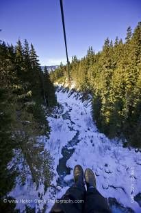 Stock photo of the view from the zipline over the Fitzsimmons Creek between Whistler and Blackcomb Mountains, Ziptrek Ecotours, zipline touring and canopy walk adventures, Whistler, British Columbia, Canada.