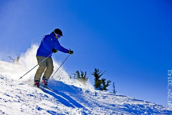 Stock photo of Skier Descending From Upper Slopes Of Whistler Mountain In Whistler British Columbia Canada