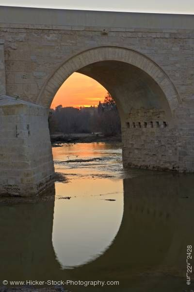 Stock photo of Puente Romano spans Rio Guadalquivir at sunset in city of Cordoba Province of Cordoba Andalusia