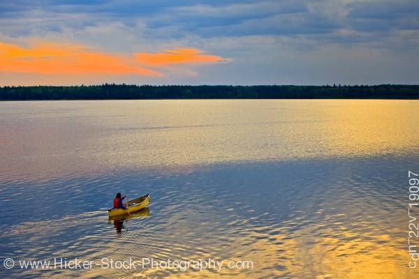 Stock photo of Canoe ride sunset Lake Audy Riding Mountain National Park Manitoba Canada