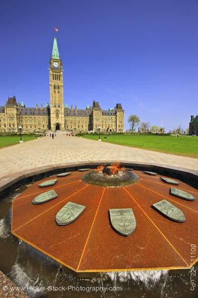 Stock photo of Centre Block and Peace Tower of the Parliament Buildings and the Centennial Flame Parliament Hill