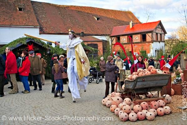Stock photo of Man stilts fairy look Christmas Market Hexenagger Castle Bavaria