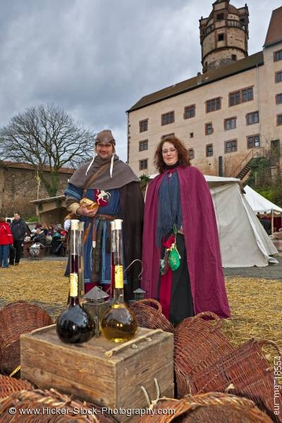 Stock photo of Couple dressed medieval clothing medieval market grounds Ronneburg Germany